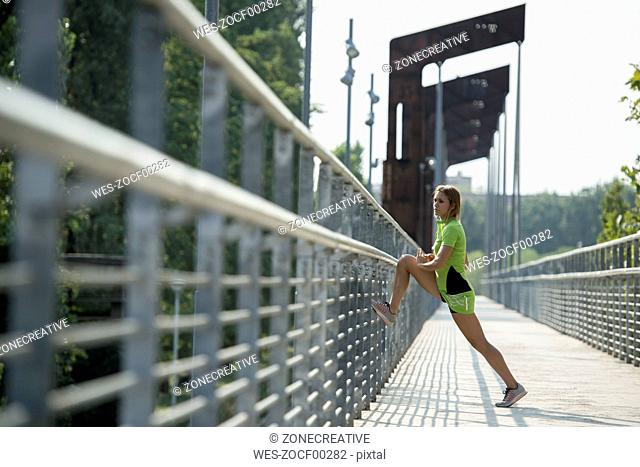 Female athlete stretching on bridge