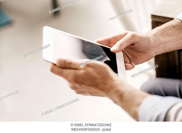 Hands of businessman holding digital tablet