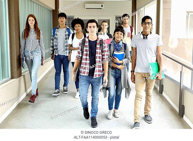Students walking in school corridor