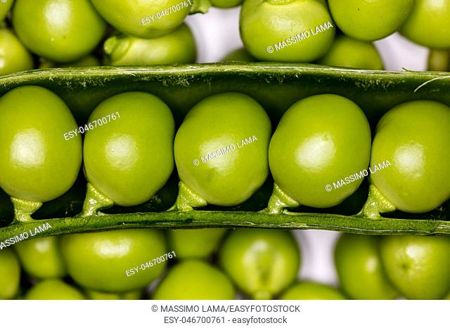 Fresh green peas closeup on a white backround