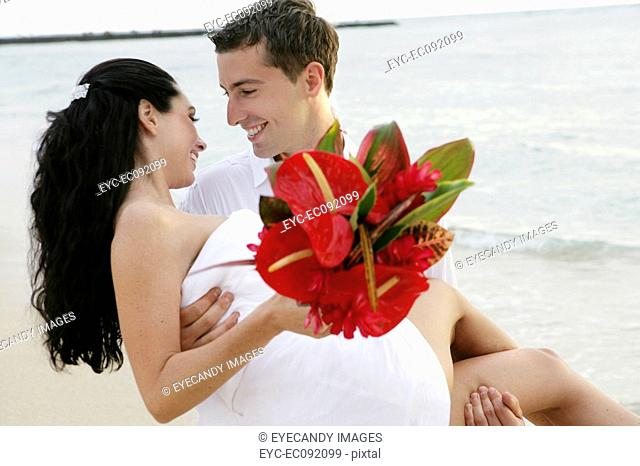 Cheerful young couple romancing outdoors