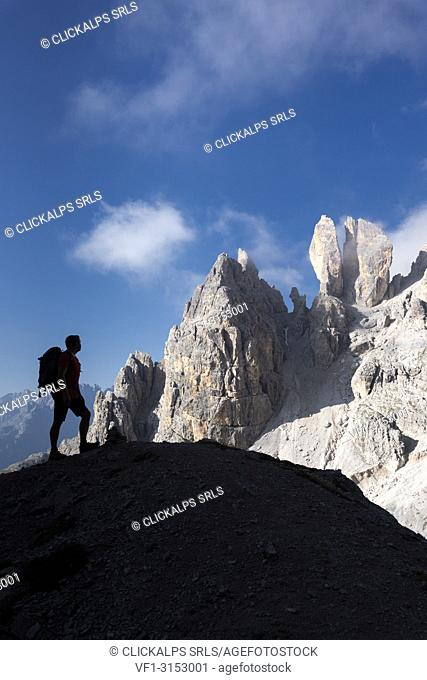 Cristallino di Misurina, Misurina, Dolomites, province of Belluno, Veneto, Italy. A climber admired the Campanile Dibona, also called lobster claw