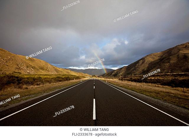 A rainbow ahead on the road to christchurch;Arthur's pass new zealand