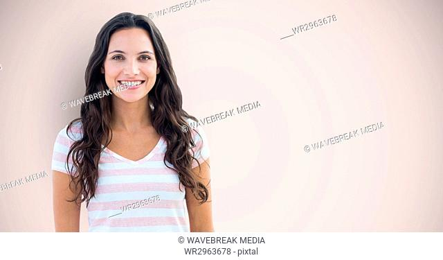 Portrait of happy female hipster standing against pink background