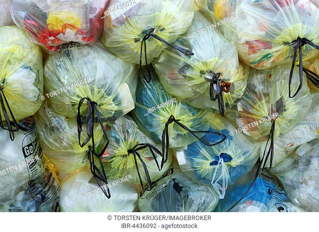 Stacked yellow bags with plastic waste, waste separation, Lower Saxony, Germany