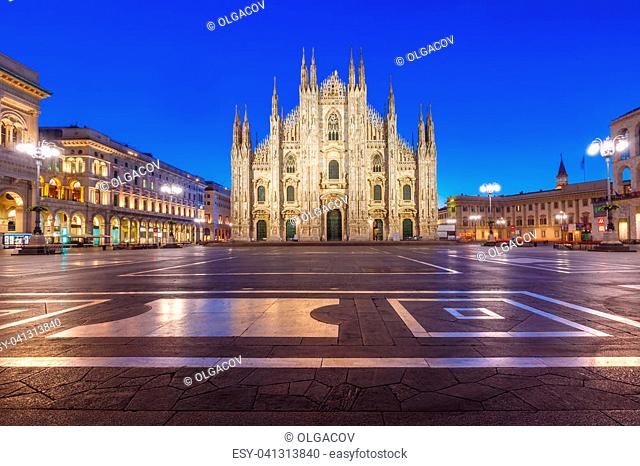 Piazza del Duomo, Cathedral Square, with Milan Cathedral or Duomo di Milano, Galleria Vittorio Emanuele II and Arengario, during morning blue hour, Milan