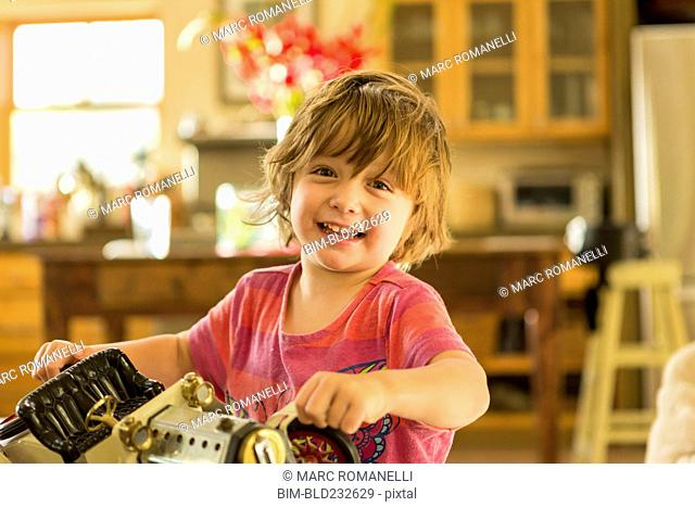 Caucasian boy holding vintage toy car