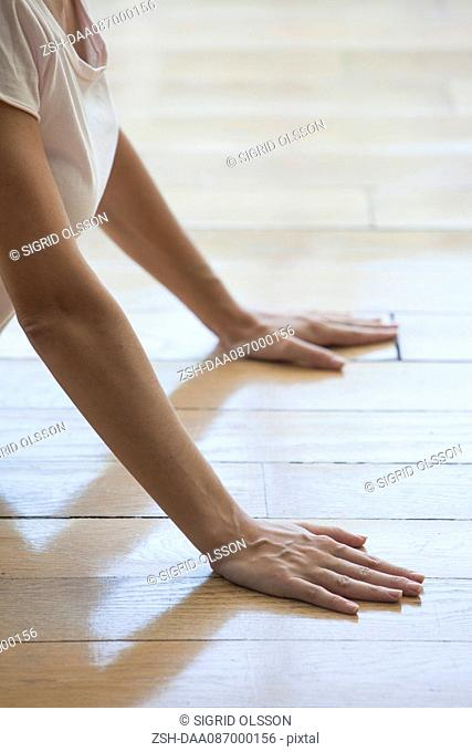 Woman stretching in cobra pose, cropped