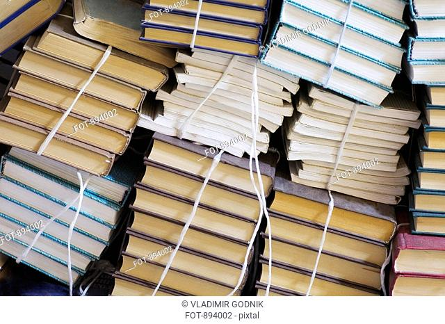 Stacks of tied up books