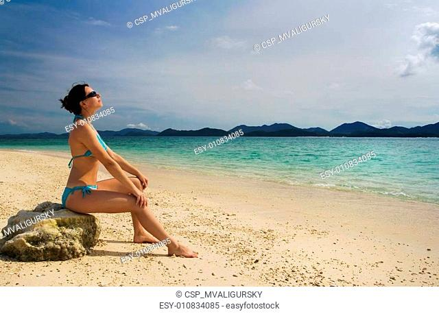Girl relaxing on tropical beach