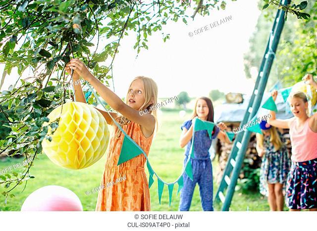 Girls decorating garden for summer party