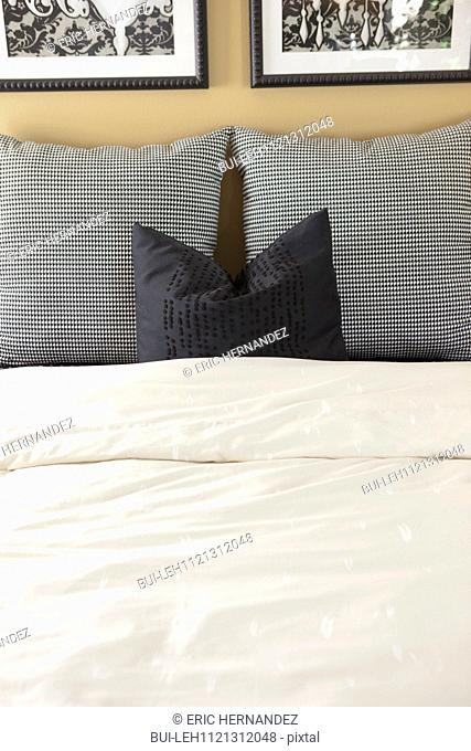 Pillows arranged on bed; Murrieta; California; USA