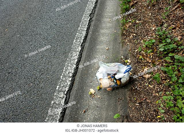 Plastic bag full of waste abandoned on the side of the road in Belgium