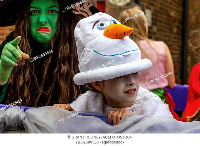 Colourful Characters Take Part In A Street Procession During The St Lawrence Fair, Hurstpierpoint, Sussex, UK