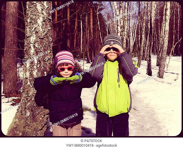 Funny children in winter forest