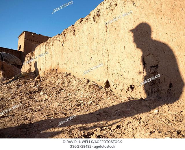 Visitor shadow on ruined wall in Ait Ben Haddou, Morocco