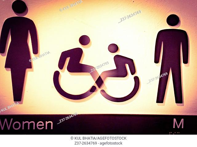 Intersection of toilet signs for men and women, Ontario, Canada