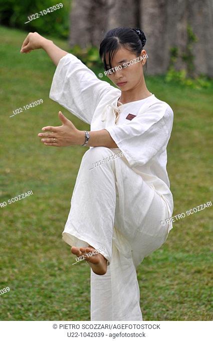 Phu Quoc (Vietnam): an employee of the Chen La Resort exercising at tai cuc quyen (Vietnamese tai chi)