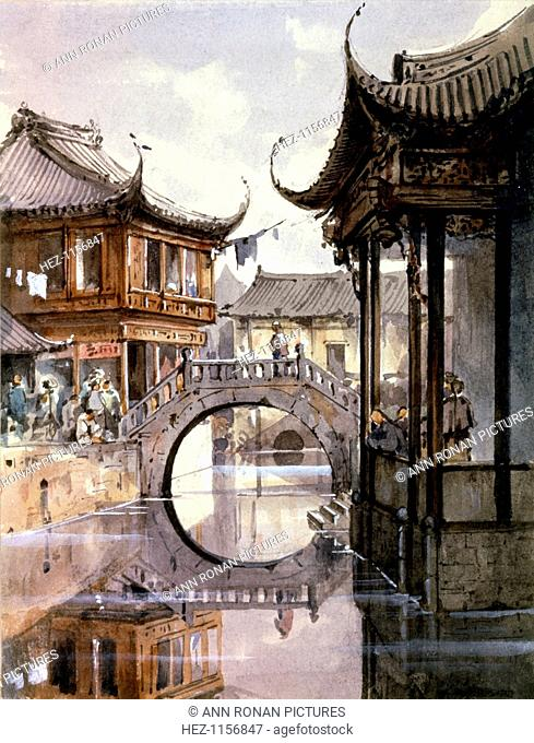 'View of Shanghai', China, c1860. View of buildings along a waterway or a canal with a semicircular arch of bridge reflected in the water