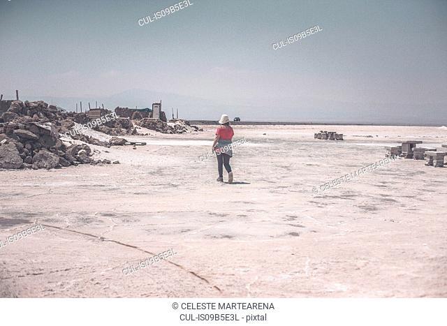 Mature woman exploring salt flats, Jujuy, Salinas Grandes, Argentina