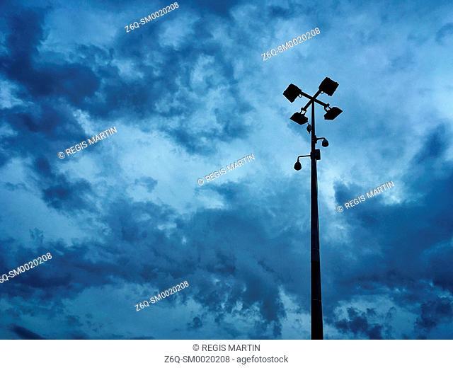 CCTV camera against a stormy sky