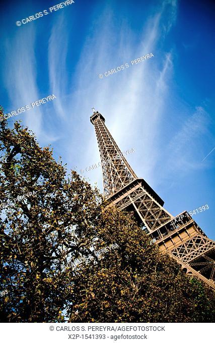 Champ de Mars, park around of Eiffel Tower, Paris, France  No building better symbolises Paris than the Tour Eiffel