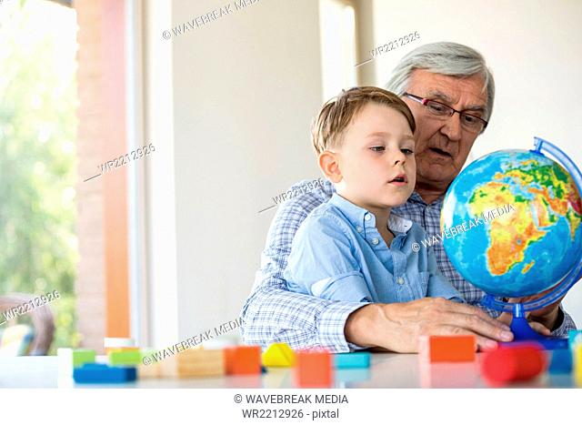 Grandfather teaching geography to grandson