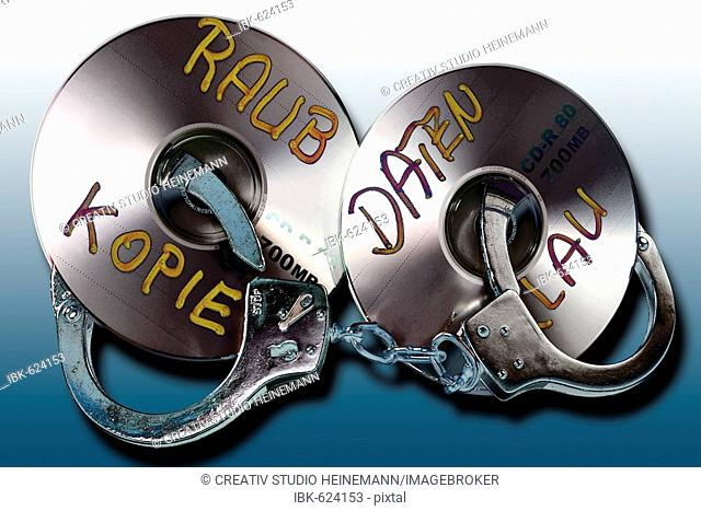 Handuffs and CD/DVD: symbolic for data theft crime