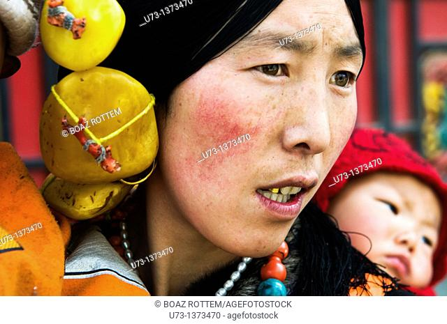 Portrait of a beautiful Tibetan woman and her baby. Photo taken in the Aba region of Eastern Tibet. ( Sichuan province)