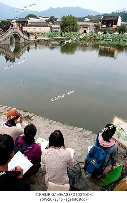 Chinese art students at work in Hongcun heritage village in Huizhou region, Anhui province