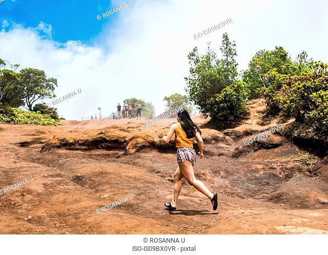 Woman in hurry, Waimea Canyon, Kauai, Hawaii