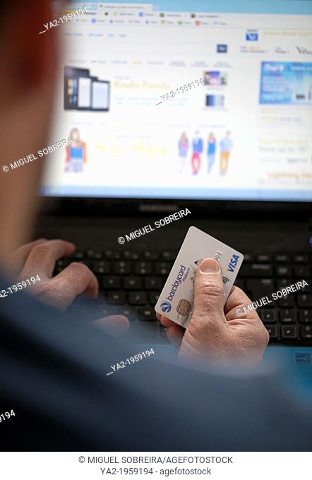 Man Shopping Online with Credit Card - UK