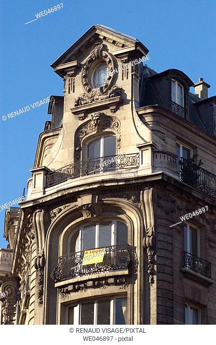 Decorated facade of apartment for rent. Paris. France