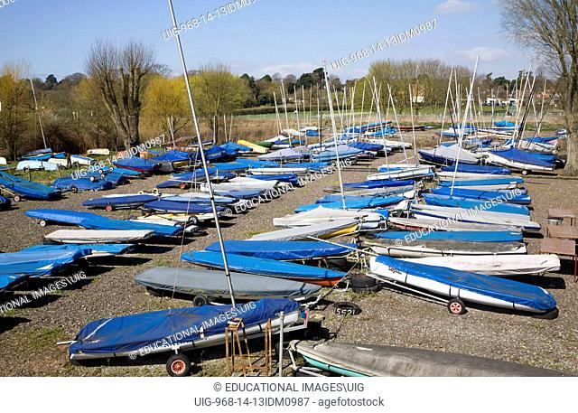 Sailing boats and dinghies in boatyard, Deben Sailing Club, Woodbridge, Suffolk, England