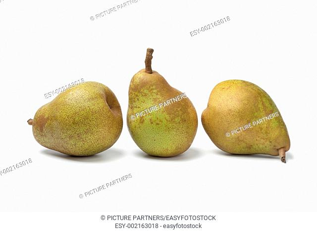 Three whole pears on white background