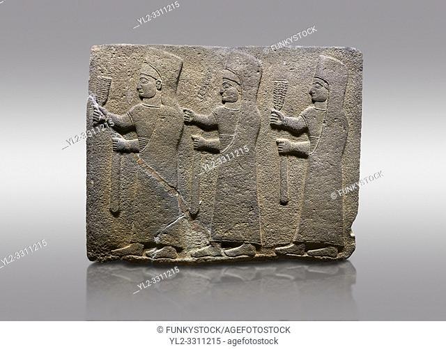 Picture & image of Hittite monumental relief sculpted orthostat stone panel of a Procession. Basalt, Karkamıs, (Kargamıs), Carchemish (Karkemish), 900-700 B