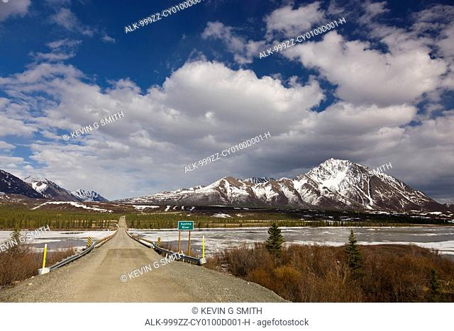 The Denali Highway bridge over the Susitna River with Clearwater Mountains in the background, Southcentral Alaska, Spring