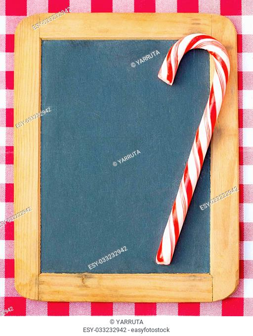 Christmas candy on vintage blackboard blank. Winter holidays concept