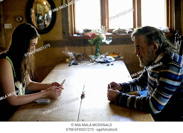 Dad playing cards with his daughter