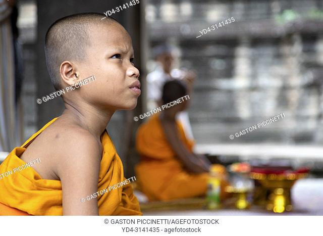 Buddhist monks in Angkor Wat Temple, Angkor Temple Complex, Siem Reap Province, Cambodia, Asia, UNESCO. It was originally constructed as a Hindu temple...