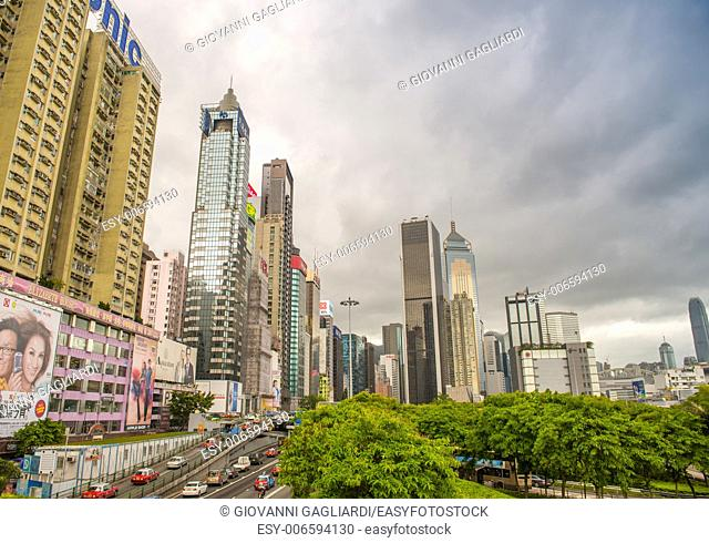 HONG KONG - MAY 6, 2014: Hong Kong skyline on a spring day. The city is a major tourist attraction with more than 30 million visitors every year