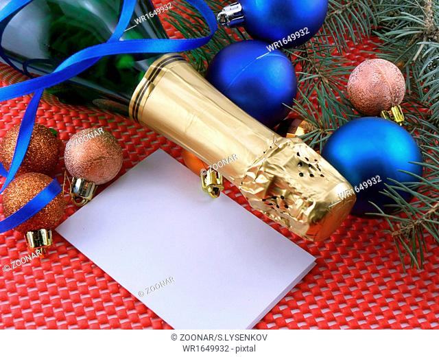 champagne bottle and christmas decoration, happy new year
