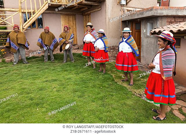 Welcoming family in the Andean village of Misminay, Peru