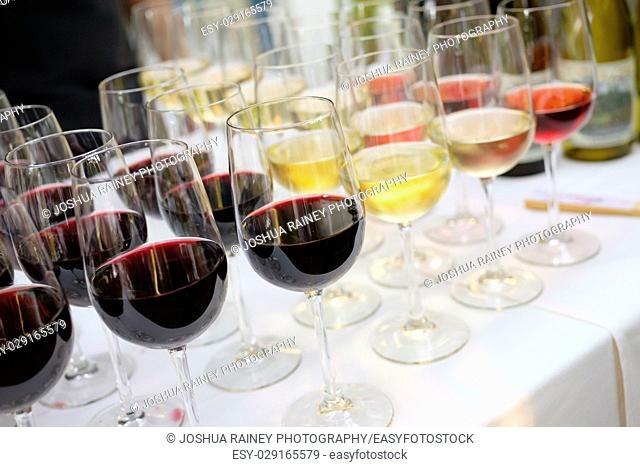 Vintage winer poured into glasses ready for guests at the bar of a wedding reception