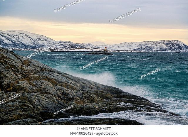 Sunset on Sommarøy overlooking the lighthouse Skarvskjær, Norway