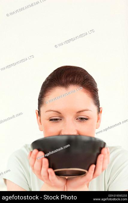 Pretty woman posing while holding a bowl