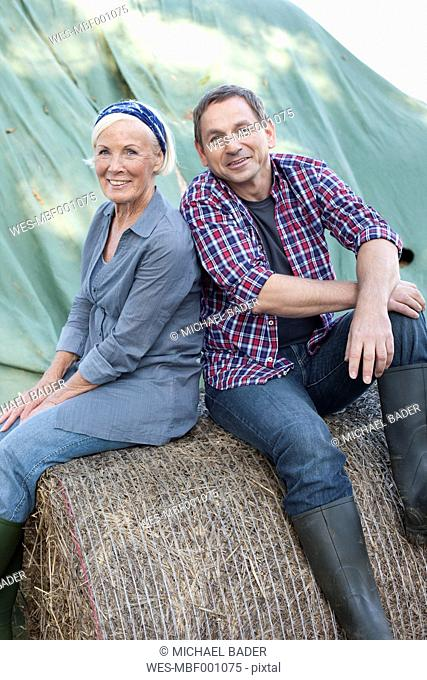 Germany, Saxony, Man and woman relaxing at the farm