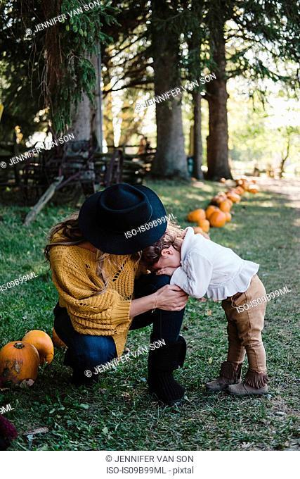 Mother comforting upset crying girl, Oshawa, Canada, North America