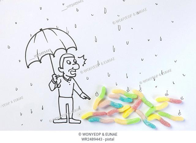 Illustration of a man holding umbrella in the rain and surprised with lots of worms