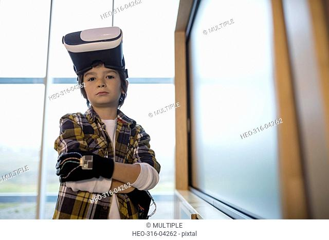Portrait confident boy wearing virtual reality simulator glasses